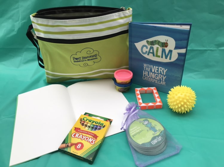 Port Discovery Virtual Support Pack featuring writing pad, crayons, book, sensory toys, play doh, and more!