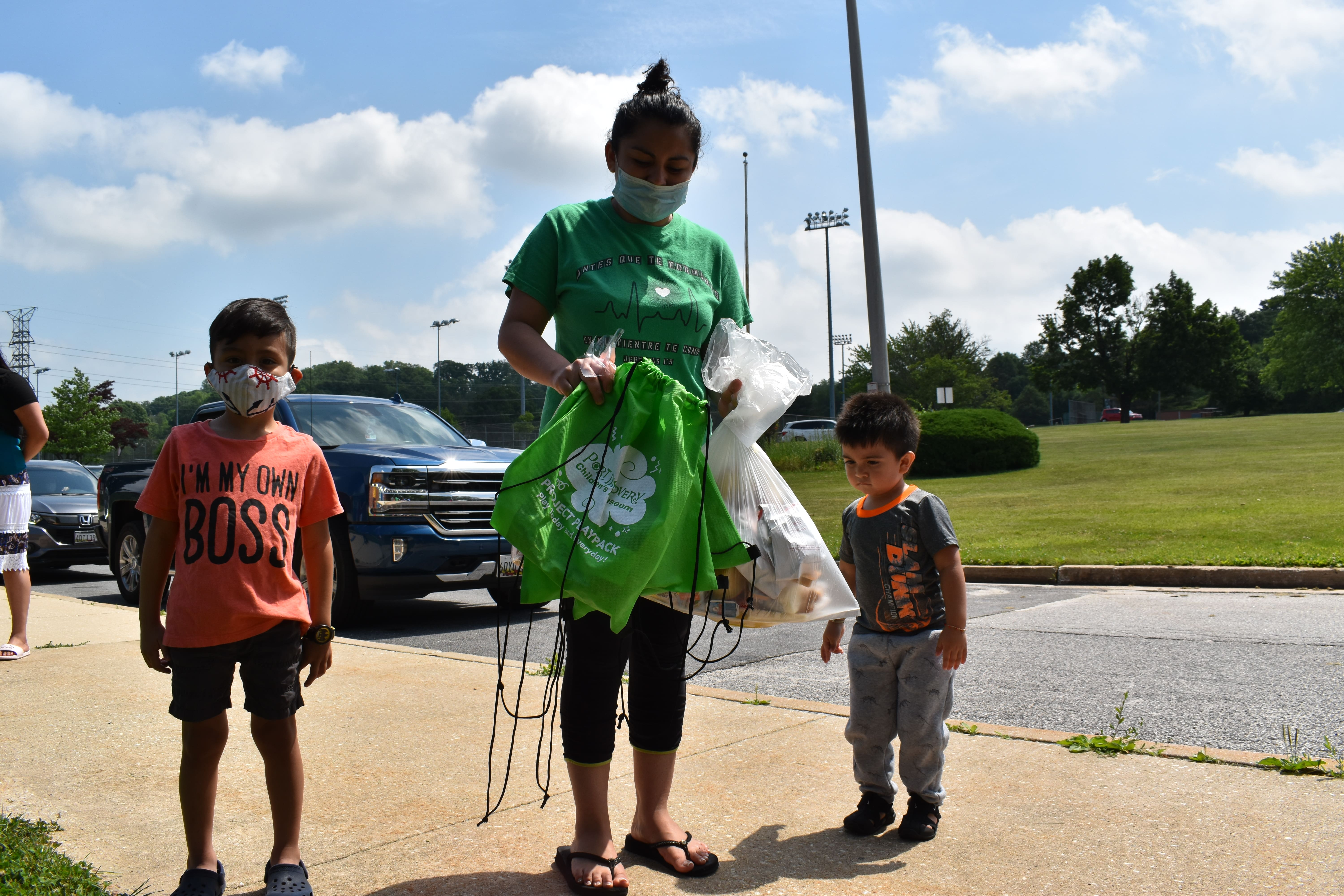 A family is given a PlayPack at Padonia International Elementary in Cockeysville in 2020, an emergency meal pickup site.