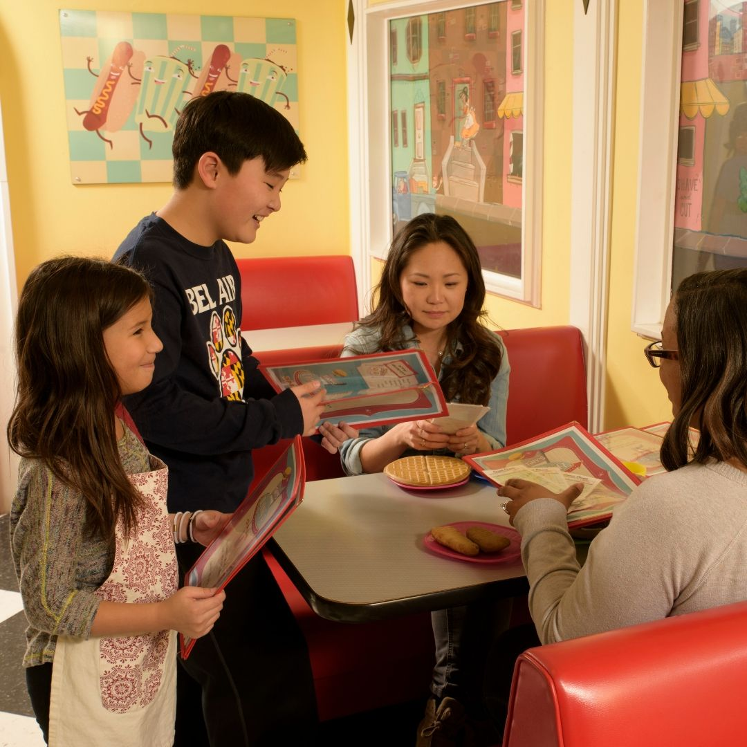 Children Serving Parents in Tiny's Diner